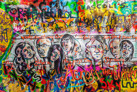 john lennon: PRAGUE, CZECH REPUBLIC - APRIL 28, 2012: Lennon Wall  is filled with John Lennon-inspired graffiti and pieces of lyrics from Beatles songs