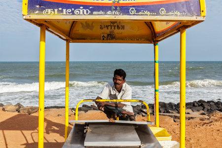 ice cream cart: PONDICHERRY, INDIA - FEBRUARY 2, 2013: Unidentified Indian street ice cream vendor with cart on beach Editorial
