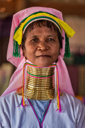 inle: INLE LAKE, MYANMAR - JANUARY 7, 2014: Unidentified Padaung long-necked tribe woman. The Padaung long-necked tribe women wear brass rings around neck from 5 years old and minority of Myanmar exploited for tourism reasons