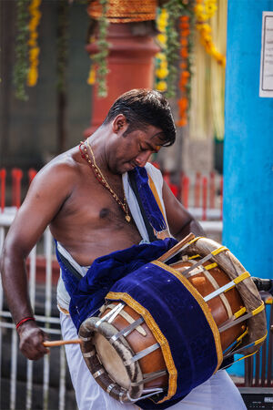 KOCHI, INDIA - FEBRUARY 24, 2013: Indian man playing drum during temple festival in Kerala