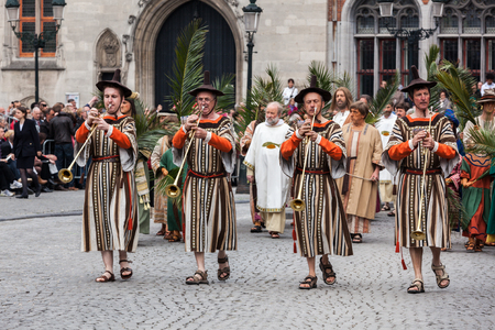 BRUGES, BELGIUM - MAY 17: Annual Procession of the Holy Blood on Ascension Day. Locals perform  dramatizations of Biblical events - the Entrance of the Lord into Jerusalem. May 17, 2012 in Bruges (Brugge), Belgium
