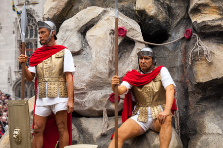 biblical events: BRUGES, BELGIUM - MAY 17: Annual Procession of the Holy Blood on Ascension Day. Roman soldiers and tomb of Christ. Locals perform an historical reenactment and dramatizations of Biblical events. May 17, 2012 in Bruges (Brugge), Belgium Editorial