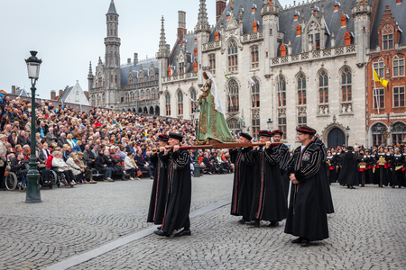 pilgrim costume: BRUGES, BELGIUM - MAY 17: Annual Procession of the Holy Blood on Ascension Day. Locals carry statue of the Virgin Mary. May 17, 2012 in Bruges (Brugge), Belgium