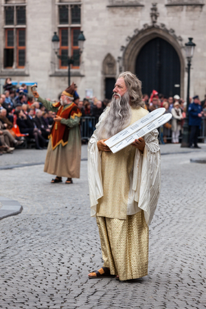 BRUGES, BELGIUM - MAY 17: Annual Procession of the Holy Blood on Ascension Day. Locals perform  dramatizations of Biblical events - Moses with the Ten Commandments. May 17, 2012 in Bruges (Brugge), Belgium