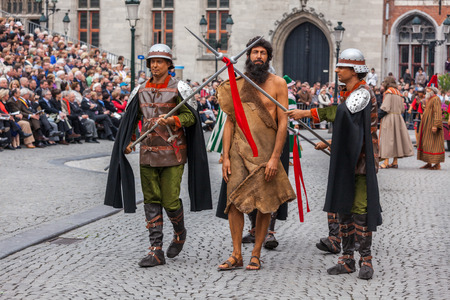 biblical events: BRUGES, BELGIUM - MAY 17: Annual Procession of the Holy Blood on Ascension Day. Locals perform  dramatizations of Biblical events - arrested John the Baptist. May 17, 2012 in Bruges (Brugge), Belgium