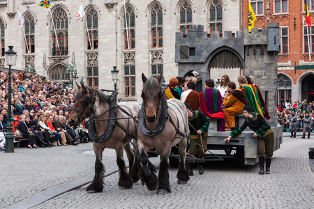 biblical events: BrUGES, BELGIUM - MAY 17: Annual Procession of the Holy Blood on Ascension Day. Locals perform  dramatizations of Biblical events - the Last Supper. May 17, 2012 in Bruges (Brugge), Belgium Editorial