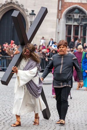 biblical events: BrUGES, BELGIUM - MAY 17: Annual Procession of the Holy Blood on Ascension Day. Locals perform  dramatizations of Biblical events - Jesus carrying cross to Golgotha. May 17, 2012 in Bruges (Brugge), Belgium