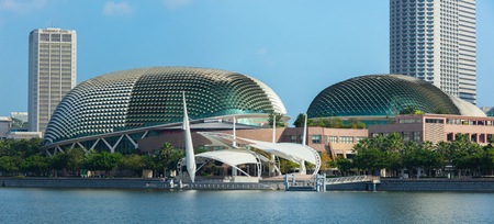 nicknamed: SINGAPORE - MAY 8: Esplanade – Theatres on the Bay concert hall  (also nicknamed Durian) at Waterfront, Marina Bay on May 8, 2011 in Singapore.  The Esplanade is one the world's busiest arts centres. Panoramic image