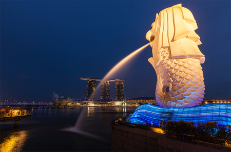 merlion: SINGAPORE - JANUARY 1, 2014: Night view of Singapore Merlion at Marina Bay and Marina Bay Sand complex.  Merlion is a well-known tourist icon, mascot and national personification of Singapore Editorial