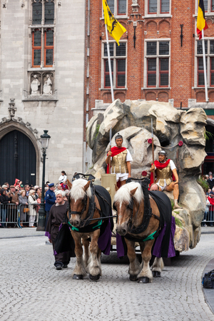 BRUGES, BELGIUM - MAY 17: Annual Procession of the Holy Blood on Ascension Day. Roman soldiers and tomb of Christ. Locals perform an historical reenactment and dramatizations of Biblical events. May 17, 2012 in Bruges (Brugge), Belgium