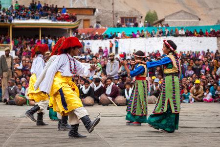 folk heritage: LEH, INDIA - SEPTEMBER 08, 2012: Young dancers in traditional Ladakhi Tibetan costumes perform folk dance at the Annual Festival of Ladakh Heritage in Leh, India. September 08, 2012