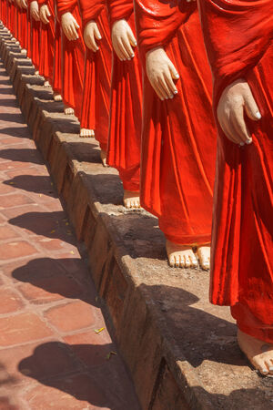 anuradhapura: ANURADHAPURA, SRI LANKA - SEPTEMBER 26, 2009: 500 statues of Buddhist monks (Arahants) in Nellikulama Temple walking after Buddha