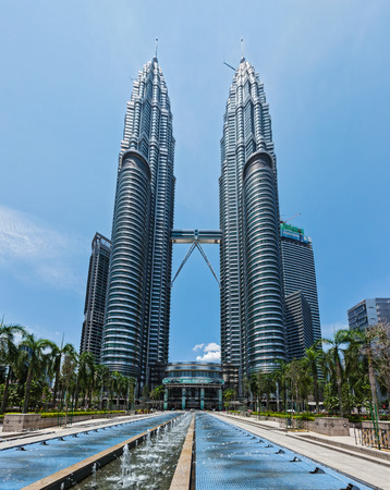 tallest: KUALA LUMPUR, MALAYSIA - MAY 5: Petronas Twin Towers in twilight on May 5, 2011 in Kuala Lumpur. They were the tallest building in the world 1998-2004 and remain the tallest twin building