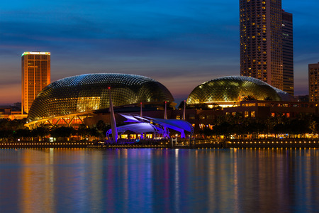 nicknamed: SINGAPORE - MAY 8: Esplanade – Theatres on the Bay concert hall  (also nicknamed Durian) at Waterfront, Marina Bay on May 8, 2011 in Singapore in the evening.  The Esplanade is one the world's busiest arts centres