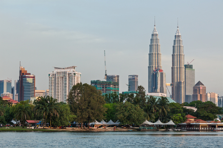 titiwangsa: KUALA LUMPUR, MALAYSIA - JUNE 19: Petronas Twin Towers on sunset on June 19, 2011 in Kuala Lumpur. They were the tallest building in the world 1998-2004 and remain the tallest twin building