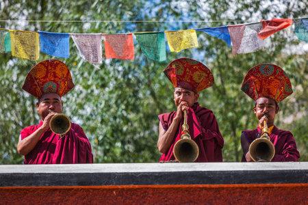 ladakh: HUNDER, INDIA - SEPTEMBER 6, 2011: Tibetan Buddhist monks playing traditional musical instruments. Hunder, Nubra valley, Ladakh, India