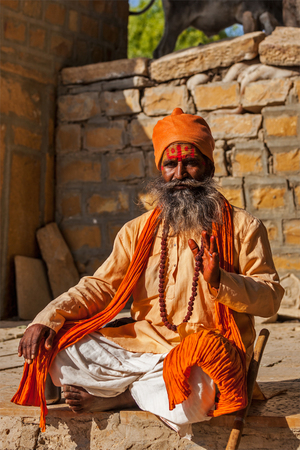 ascetic: JAISALMER, INDIA - NOVEMBER 28, 2012: Indian sadhu (holy man) blessing. Sadhus are holy men who live ascetic life and focus on spiritual practice of Hinduism