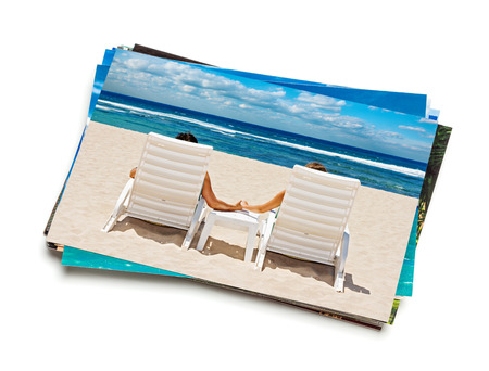 Holidays beach concept creative background - stack of vacation photos with couple on beach image on top isolated on white background Reklamní fotografie