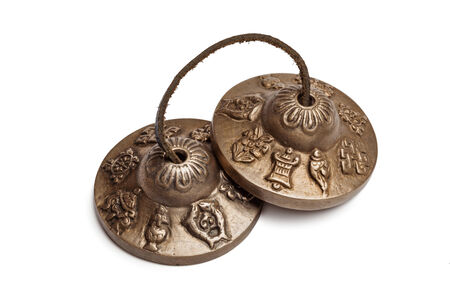 cymbals: Tibetan Buddhist tingsha cymbals isolated Stock Photo