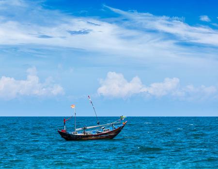 ne: Fishing boat  in sea. Mui Ne, Vietnam