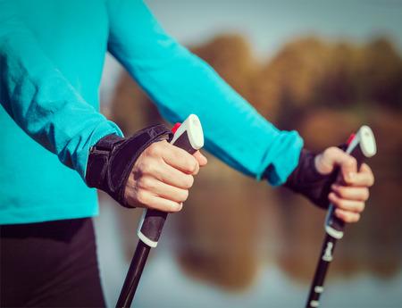 walking pole: Womans hand holding nordic walking poles Stock Photo