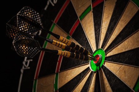 Three darts in bulls eye close up Stock Photo