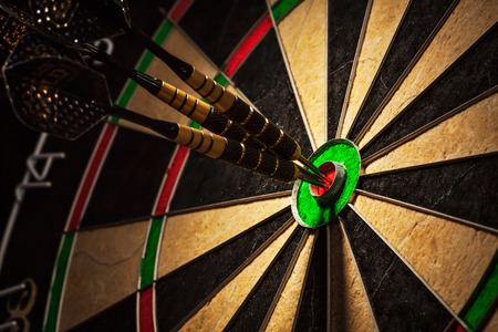 Three darts in bulls eye close up Stok Fotoğraf