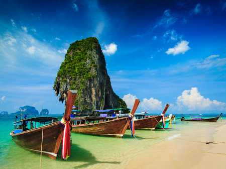 karst: Long tail boat on beach, Thailand