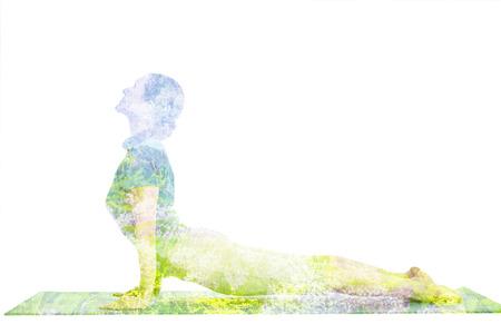 Double exposure image of woman doing yoga