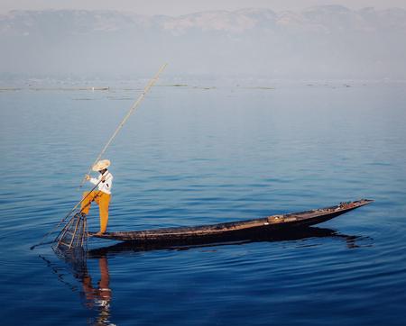 inlay: Traditional Burmese fisherman at Inle lake, Myanmar