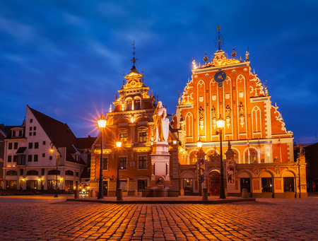 town hall square: Riga Town Hall Square, House of the Blackheads and St. Roland Statue illuminated in the evening twilight, Riga, Latvia Stock Photo