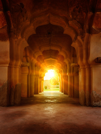 ancient buildings: Old ruined arch in ancient palace at sunset Stock Photo