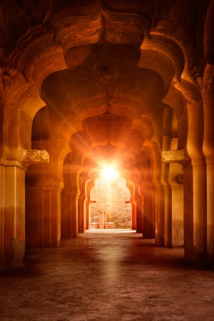 karnataka culture: Old ruined arch in ancient palace at sunset Stock Photo