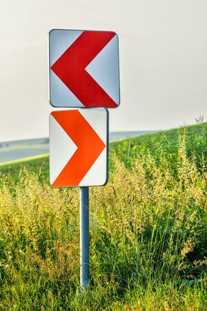 curve road: Road curve signs Stock Photo