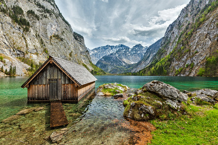 and germany: Boat dock hangar on Obersee mountain lake in Alps. Bavaria, Germany