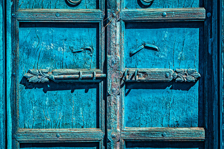 latch: Latch with padlock on old textured door in India