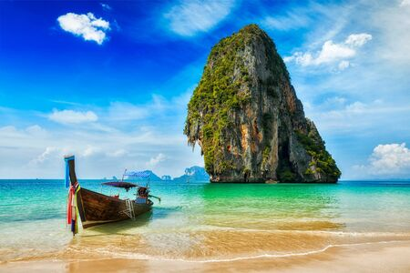 longtail: Tropical vacation holiday beach concept - Long tail boat on tropical beach, Krabi, Thailand Stock Photo