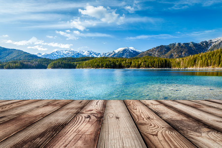 Wooden planks European nature background with lake in Alps, Germany Standard-Bild