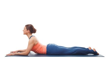 bhujangasana: Beautiful sporty fit yogini woman practices yoga asana salamba bhujangasana - sphinx pose beginnner backbend variation isolated on white