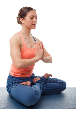 meditates: Beautiful sporty fit yogini woman meditates in yoga asana Padmasana - lotus pose with namaste Stock Photo