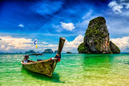 tropical beach: Long tail boat on tropical beach (Pranang beach) and rock, Krabi, Thailand