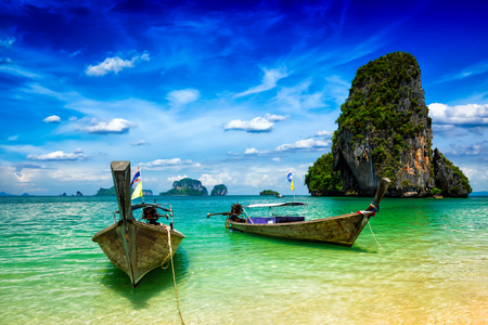 island: Long tail boats on tropical beach (Pranang beach), Krabi, Thailand