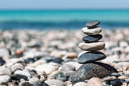 Zen meditation background -  balanced stones stack close up on sea beach Zdjęcie Seryjne - 43867175