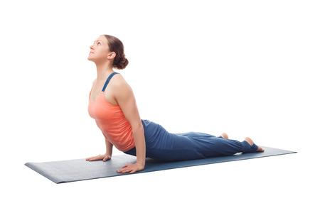 yogini: Beautiful sporty fit yogini woman practices yoga asana urdhva mukha svanasana - upward facing dog pose isolated on white Stock Photo