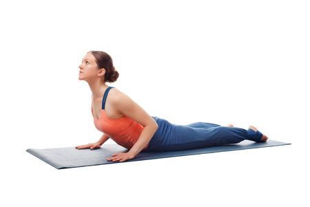 bhujangasana: Beautiful sporty fit yogini woman practices yoga asana bhujangasana - cobra pose beginner variation isolated on white background