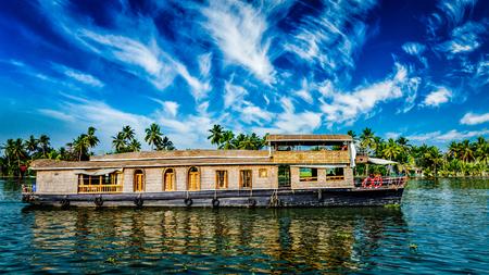 Kerala India  travel background - panorama of tourist houseboat on Kerala backwaters. Kerala, India