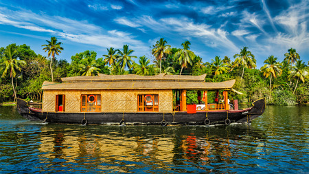 Travel tourism Kerala background - panorama of tourist houseboat on Kerala backwaters. Kerala, India Stock Photo
