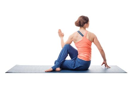 ardha: Beautiful sporty fit yogini woman practices yoga asana ardha matsyendrasana - half spinal twist pose isolated on white background