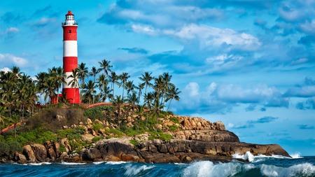 kovalam: Panorama of lighthouse and sea with waves. Kovalam (Vizhinjam) Kerala, India