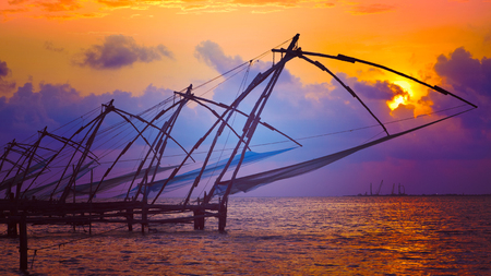 medias de red: Panorama of Kochi tourist attraction - chinese fishnets on sunset with grunge texture overlaid. Fort Kochin, Kochi, Kerala, India